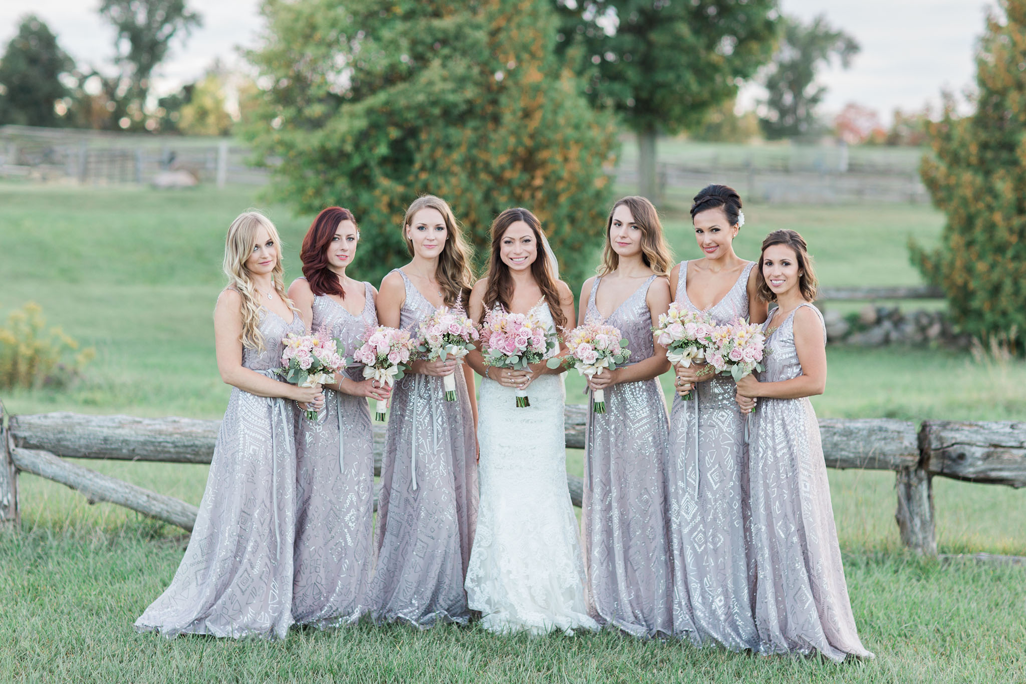 Bridal Party Photos. One bride with 6 bridesmaids, all holding flowers