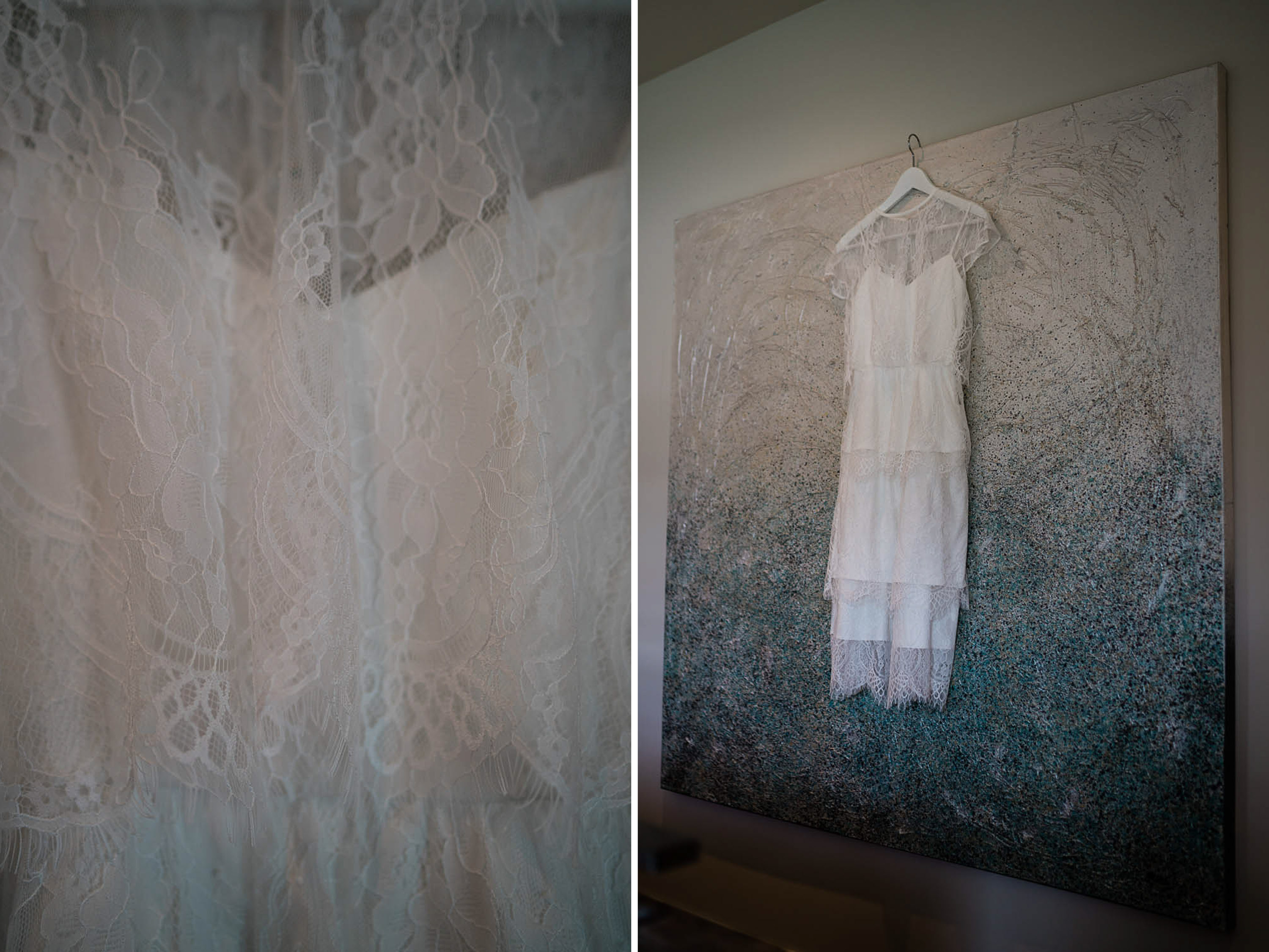 Wedding dress hanging up on modern painting.