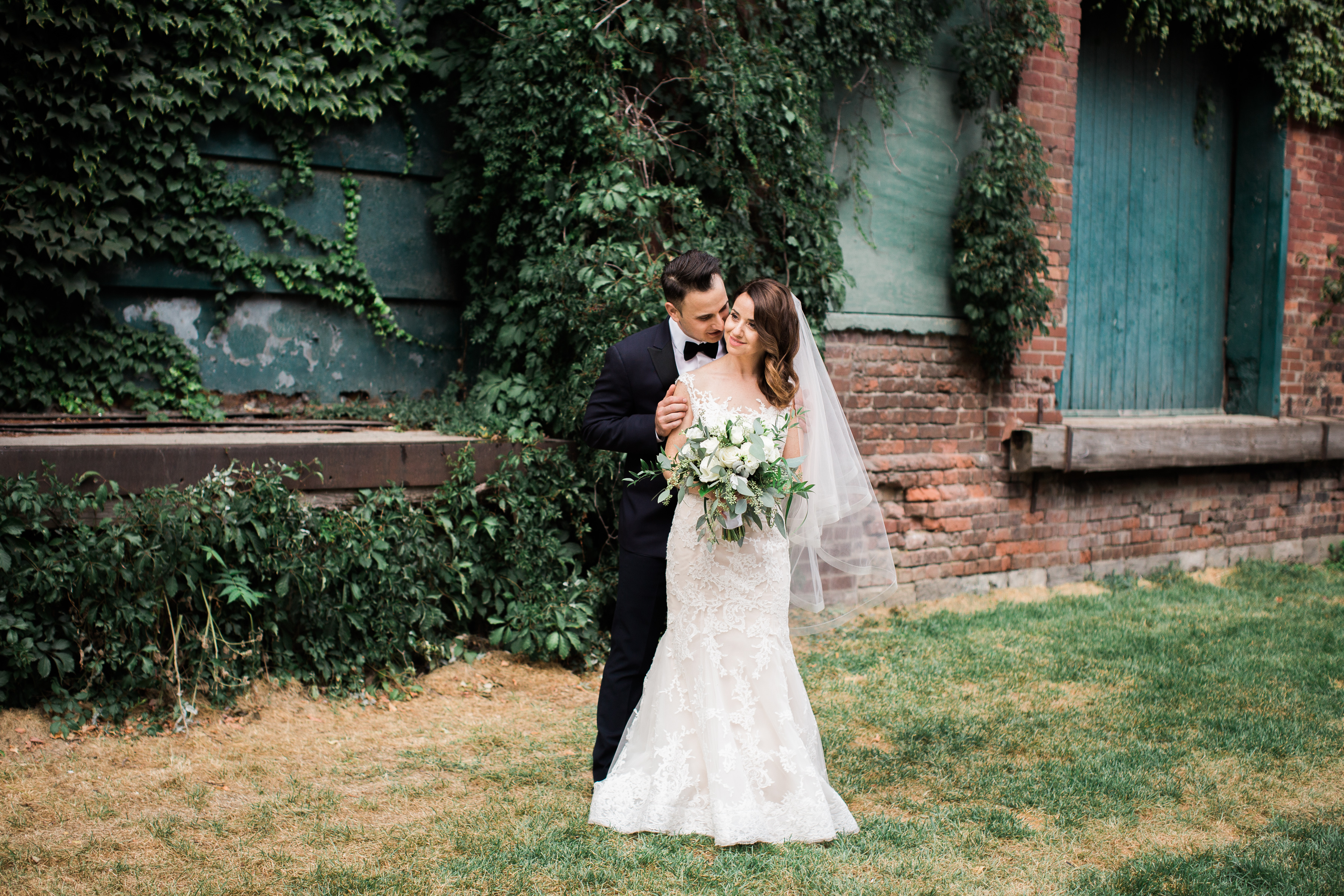 Bride and groom at Distillery District enjoying a quiet moment.