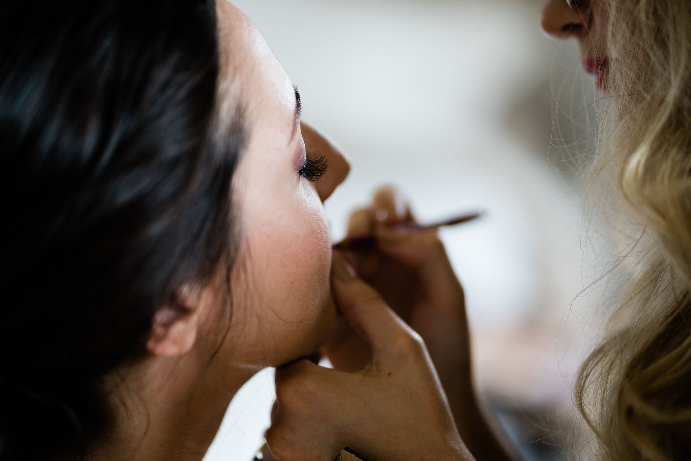 Bride having her makeup done by a professional.