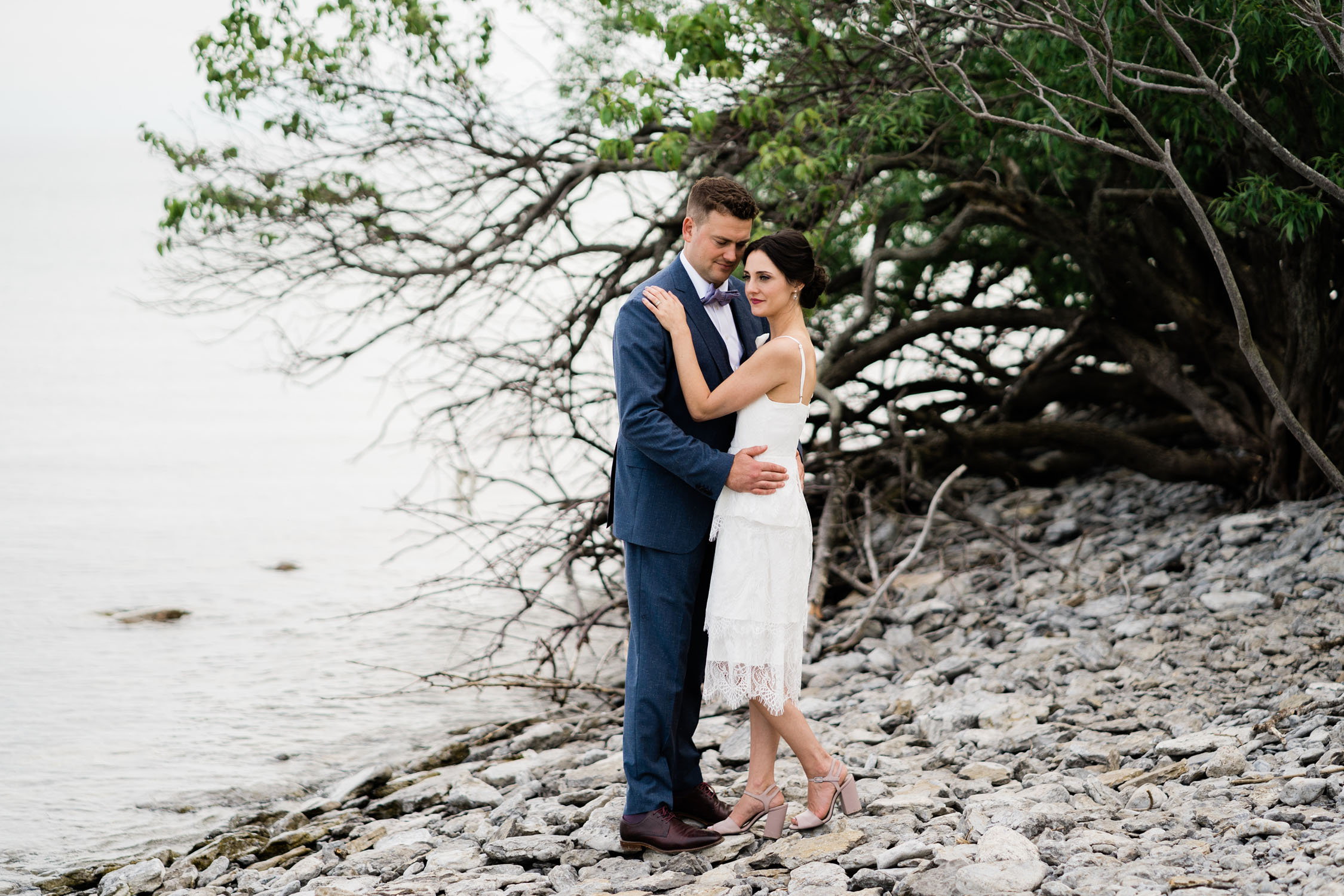 Couple from Compass Rose wedding on Peters Point in Prince Edward County wedding.