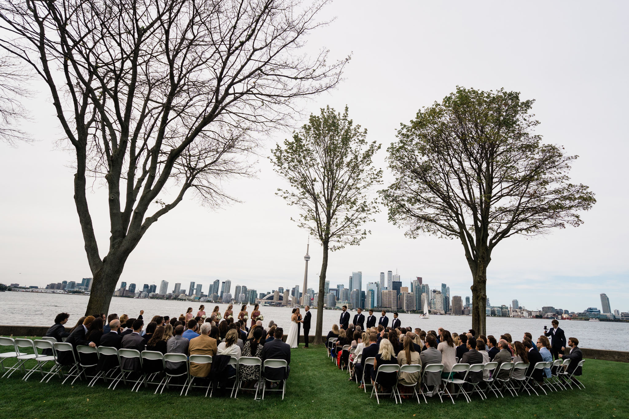 City skyline in the background. Couple getting married.