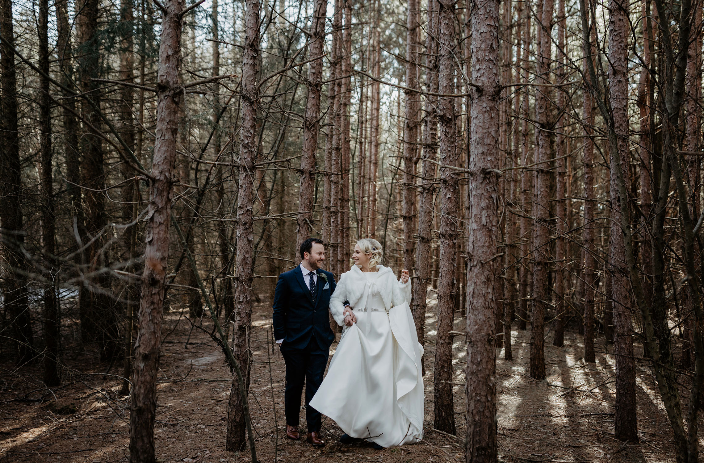 Couple laughing the the forest.