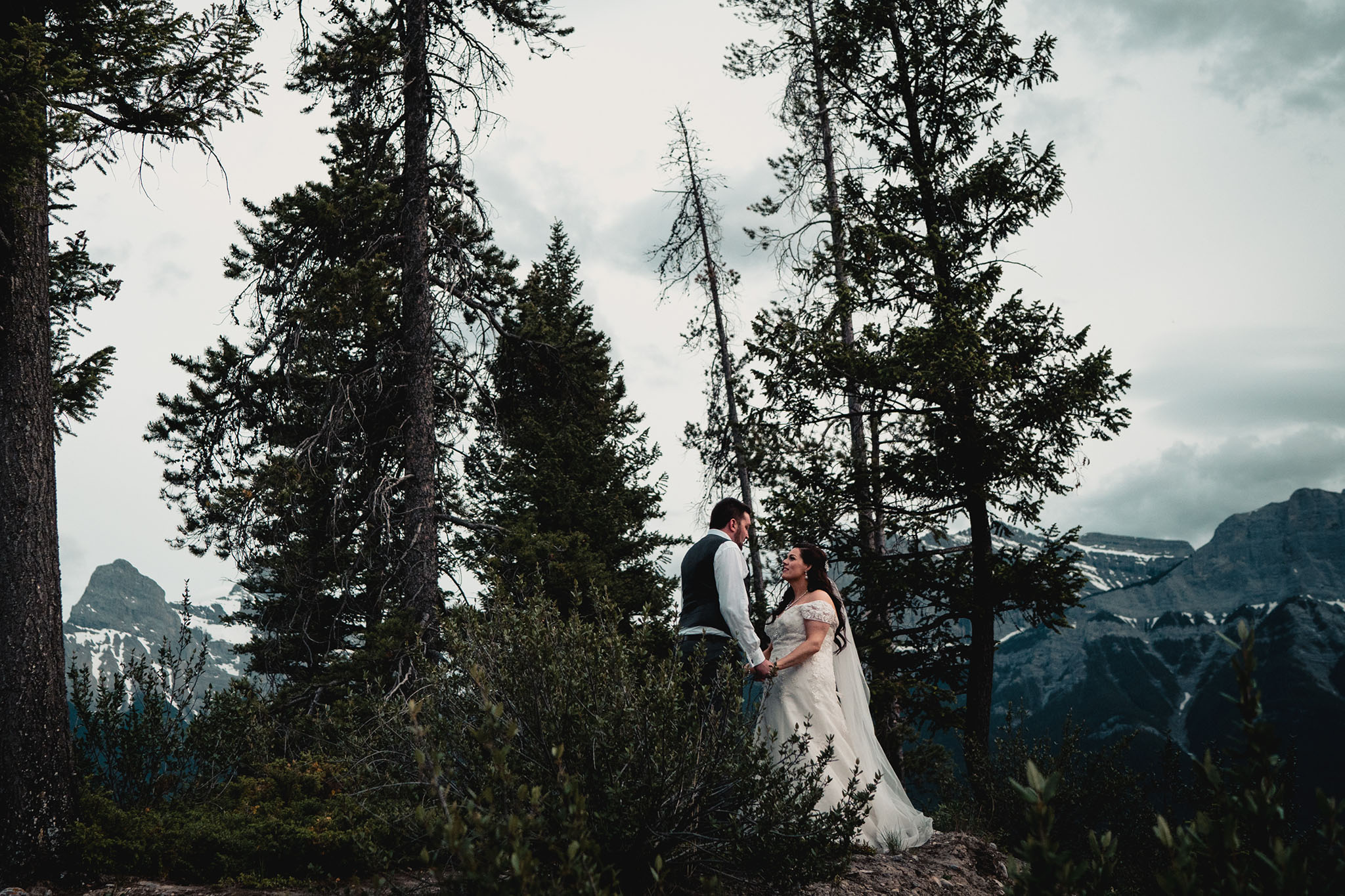 Gorgeous couple with the Rocky Mountains behind them as a backdrop.